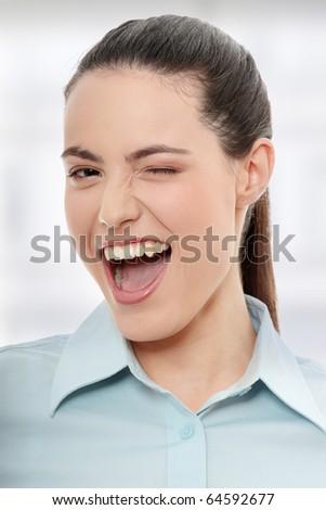 Businesswoman with big smile blinking. - stock photo