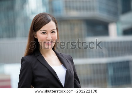 Businesswoman with business background - stock photo