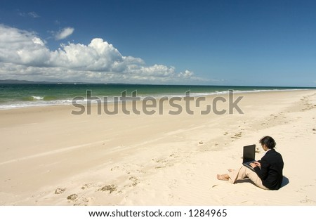 Businesswoman with business suit working at the beach