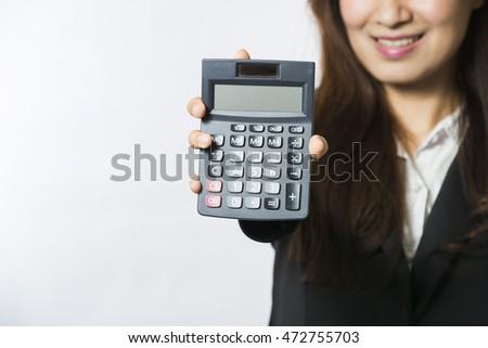 Businesswoman with calculator, isolated on white background