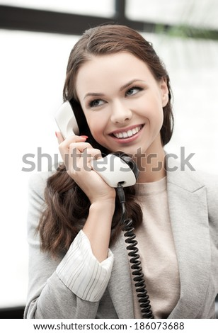 businesswoman with cell phone calling or talking - stock photo