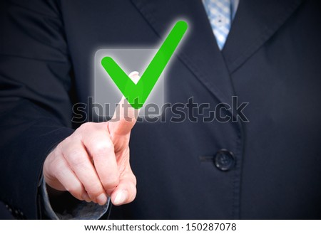 Businesswoman with check box - stock photo