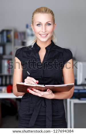 Businesswoman with checklist; teeth smile
