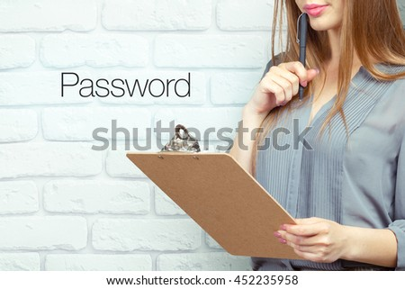 "businesswoman with clipboard and pen making notes and standing near text ""Password"" - stock photo"