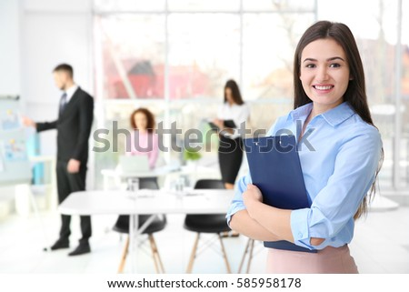 Businesswoman with clipboard in office