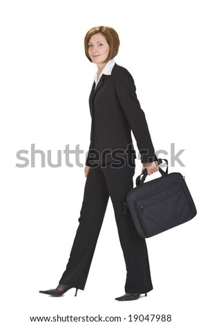 Businesswoman with computer bag walking.