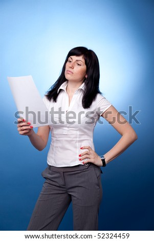 Businesswoman with documents on blue background
