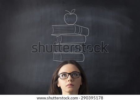 Businesswoman with drawing books on her head - stock photo