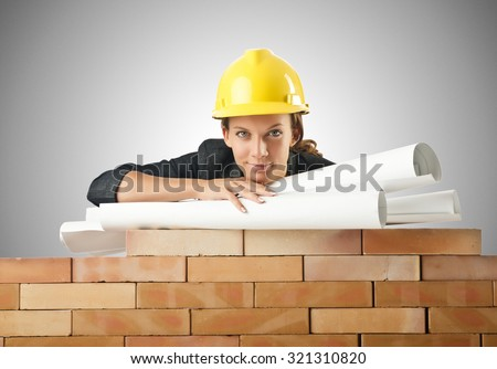 Businesswoman with drawings near brick wall - stock photo