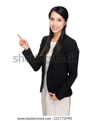 Businesswoman with finger point up - stock photo