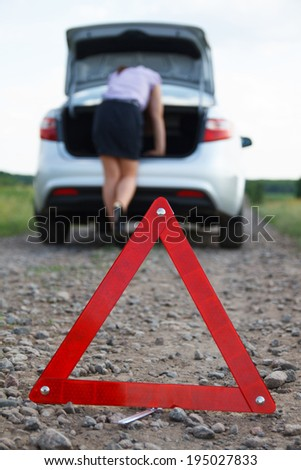 businesswoman with flat tire