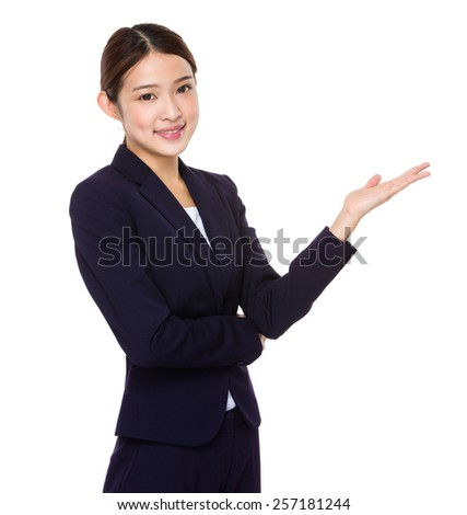 Businesswoman with hand presentation