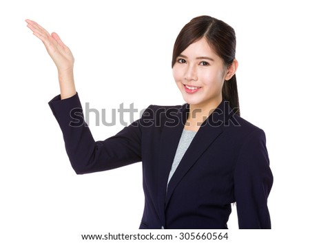 Businesswoman with hand showing blank sign - stock photo