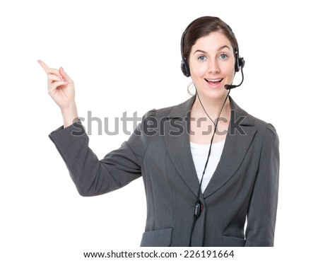 Businesswoman with headset and finger point up