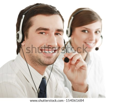 Businesswoman with headset  in call center. Businessman in headsets on background - stock photo