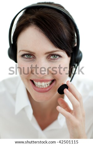 Businesswoman with headset on smiling at the camera isolated on a white background