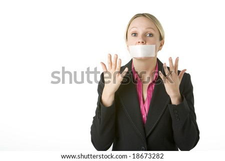 Businesswoman With Her Arms Folded And Mouth Taped Shut - stock photo