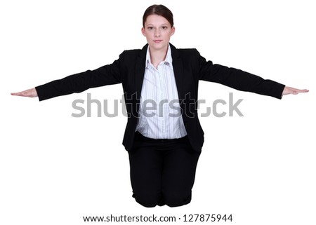 Businesswoman with her arms out - stock photo
