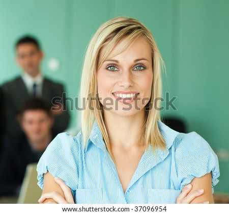 Businesswoman with her team of work in a green office - stock photo