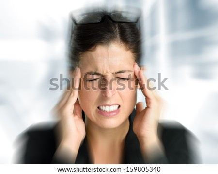 Businesswoman with intense stress and painful headache. Woman in job problems. - stock photo