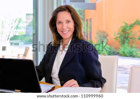 Businesswoman with laptop - stock photo