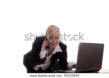 Businesswoman with Laptop and phone - stock photo
