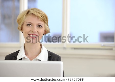 businesswoman with laptop at the office - stock photo