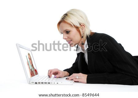 Businesswoman with laptop on white