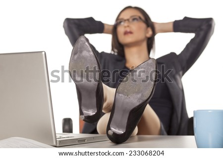 businesswoman with legs on the table in the relax situation - stock photo