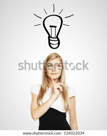 businesswoman with lightbulb over head - stock photo