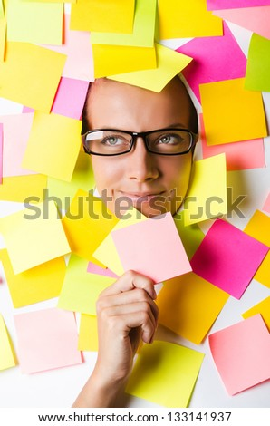 Businesswoman with lots of reminder notes