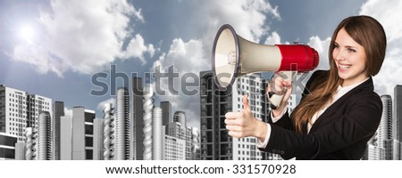 Businesswoman with loudspeaker on the urban background. - stock photo