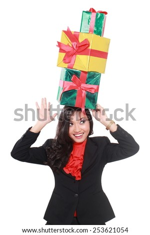 businesswoman with many gifts over the head, isolated on white background - stock photo