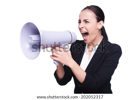 Businesswoman with megaphone. Side view businesswoman screaming in megaphone over white background