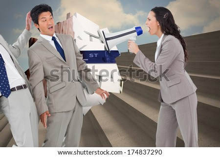 Businesswoman with megaphone yelling at colleagues against steps against blue sky - stock photo