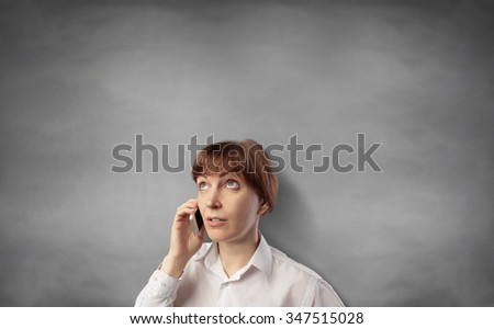 businesswoman with mobile phone - stock photo