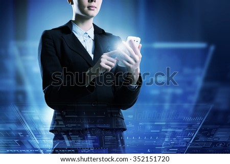 Businesswoman with mobile phone against high tech background - stock photo