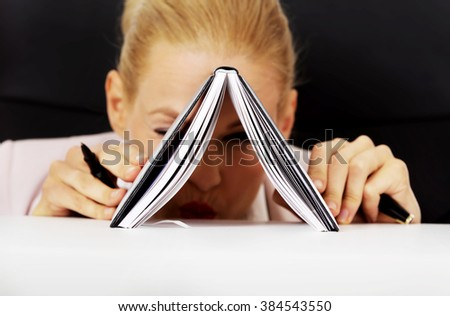 Businesswoman with notebook - stock photo