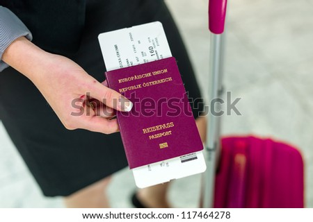 businesswoman with passport, luggage and flight ticket at the airport. business trip - stock photo