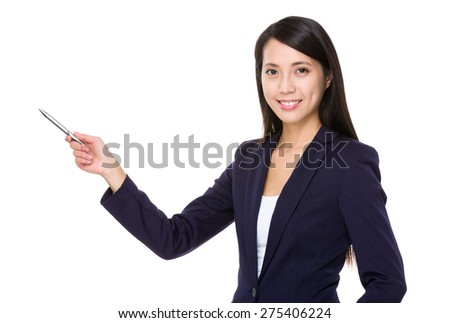 Businesswoman with pen point aside - stock photo
