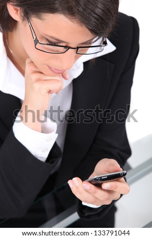 Businesswoman with phone - stock photo