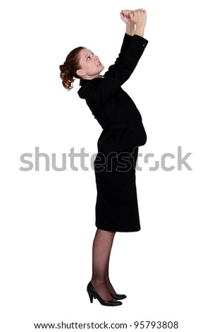 Businesswoman with raised arms - stock photo