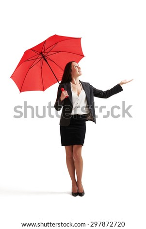 businesswoman with red umbrella held out her hand and looking up. isolated on white background - stock photo