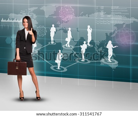 Businesswoman with suitcase showing ok on abstract background with world map