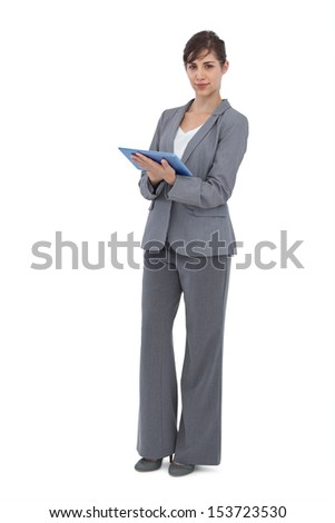 Businesswoman with tablet computer on white background - stock photo