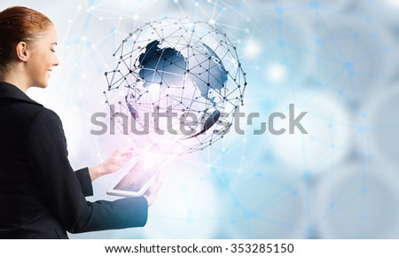 Businesswoman with tablet pc against high tech background