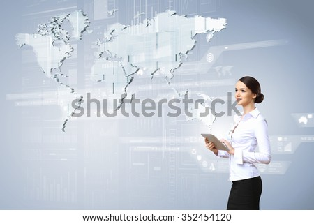 Businesswoman with tablet pc against high tech blue background