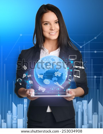 businesswoman with tablet pc against high-tech technology. - stock photo