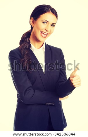 Businesswoman with thumb up gesture. - stock photo