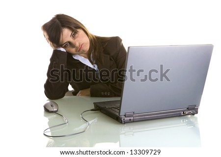 businesswoman with tired expression working with laptop computer isolated on white background - stock photo